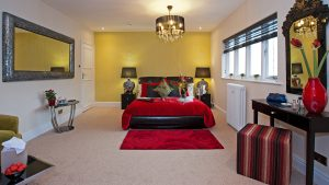 Amaryllis Room View Showing Effective Colour Scheme of Red, Yellow, Cream and berber carpet